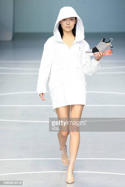 A model showcases designs on the runway during the Qiaodan Cup 13th China Sports Wear Design Contest on day four of the China Fashion Week...