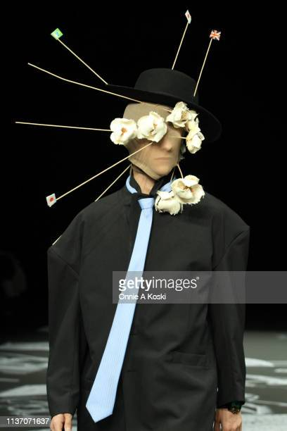 Model showcases designs on the runway during the RYOTAMURAKAMI show as part of Amazon Fashion Week TOKYO 2019 A/W at Shibuya Hikarie Hall on March...
