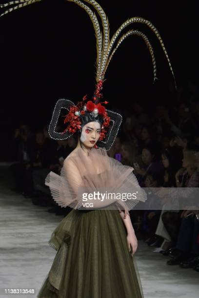 Model showcases designs on the runway during the Sheguang Hu Collection show on day one of China Fashion Week A/W 2019/2020 at the 751D Park on March...