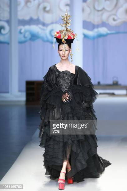 A model showcases designs on the runway during the Snowwhite show by designer Feng Sansan on day five of the China Fashion Week Spring/Summer 2019 at...