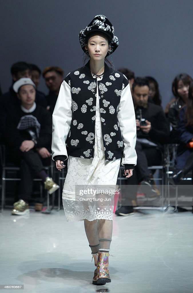 A model showcases designs on the runway during the Steve J and Yoni P show as part of Seoul Fashion Week F/W 2014 on March 24, 2014, in Seoul, South Korea.