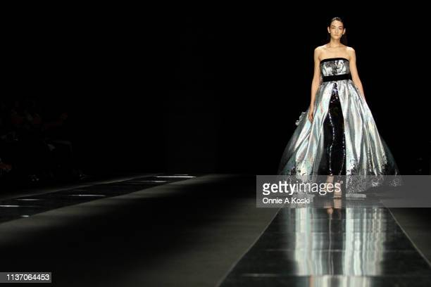 Model showcases designs on the runway during the TAE ASHIDA show as part of Amazon Fashion Week TOKYO 2019 A/W at Roppongi Hills on March 20, 2019 in...
