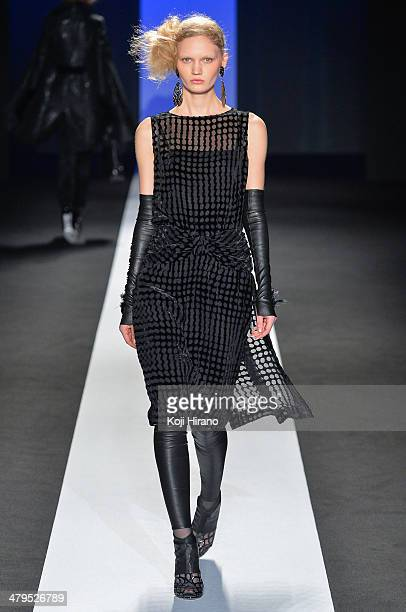 A model showcases designs on the runway during the TAE ASHIDA show as part of Mercedes Benz Fashion Week TOKYO 2014 A/W at Shibuya Hikarie on March...