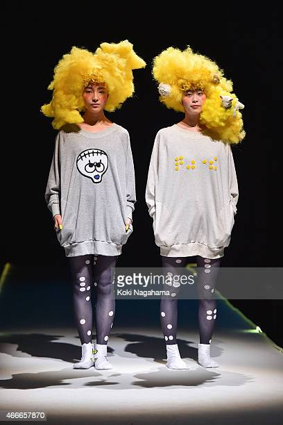A model showcases designs on the runway during the tenbo show as part of Mercedes Benz Fashion Week TOKYO 2015 A/W at Shibuya Hikarie on March 18...