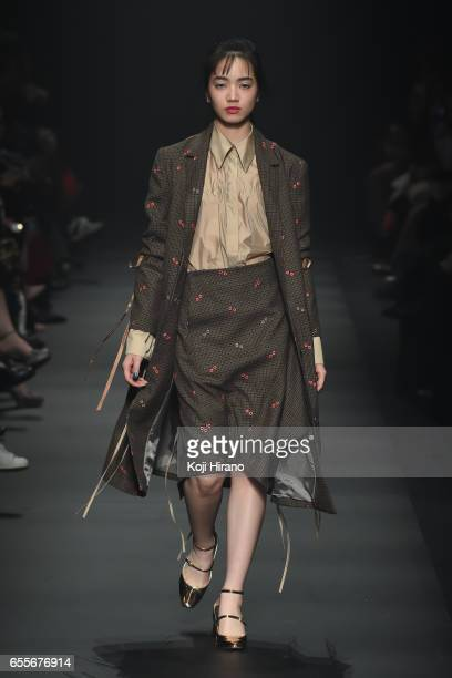 Model showcases designs on the runway during the tilt tokyo show as a part of Amazon Fashion Week Tokyo A/W 2017 at Shibuya Hikarie on March 20, 2017...