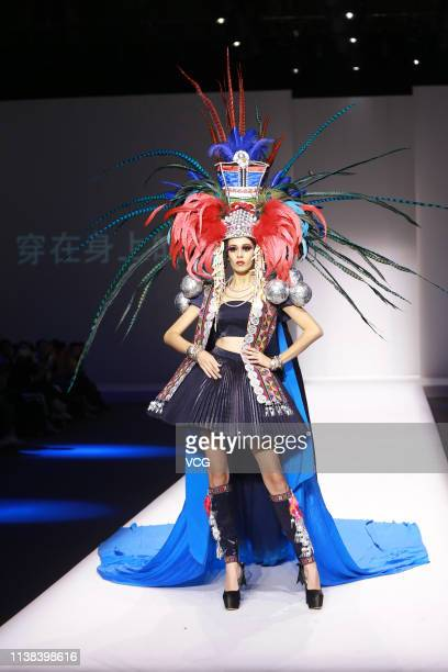 A model showcases designs on the runway during the We Wear Culture Collection show by designer Zhang Kejia on day two of China Fashion Week A/W...