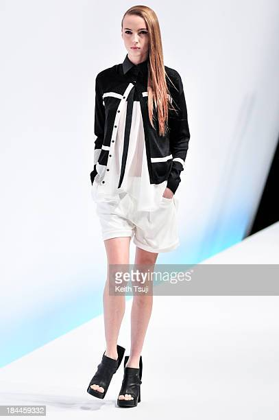 A model showcases designs on the runway during the Yasutoshi Ezumi show as part of Mercedes Benz Fashion Week Tokyo S/S 2014 at Hikarie Hall B of...