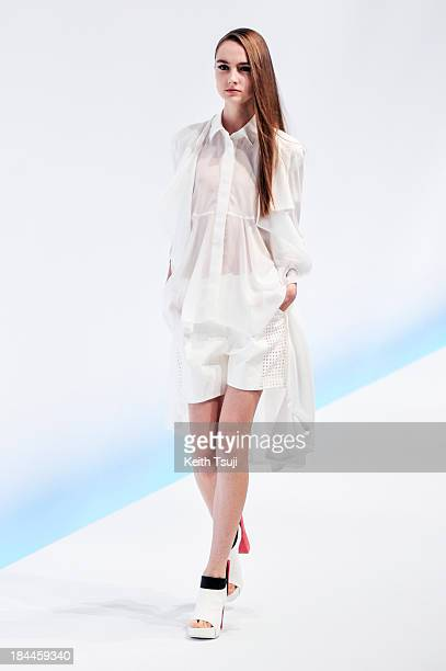 Model showcases designs on the runway during the Yasutoshi Ezumi show as part of Mercedes Benz Fashion Week Tokyo S/S 2014 at Hikarie Hall B of...