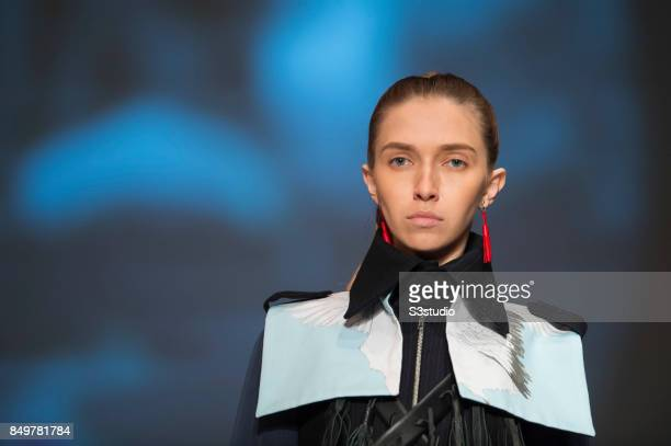 Model showcases designs The Passerby by Eva Choi during the Visceral Instinct show by Raffles Hong Kong as part of the Fashion Week for Spring /...