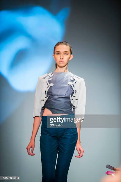 Model showcases designs Trapped In The Multiverses by Chu Tin Lok Tina during the Visceral Instinct show by Raffles Hong Kong as part of the Fashion...