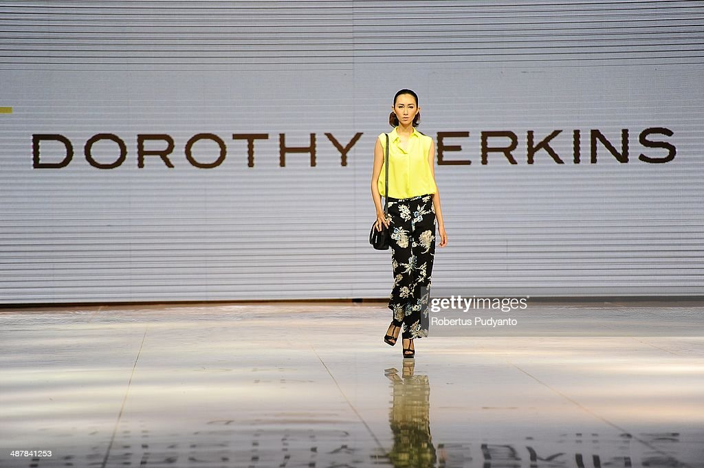 A model showcases Dorothy Perkins Collection on the runway during The 7th Surabaya Fashion Parade 'NIWASANA NUSANTARA 2014' day two at Tunjungan Plaza on May 2, 2014 in Surabaya, Indonesia.