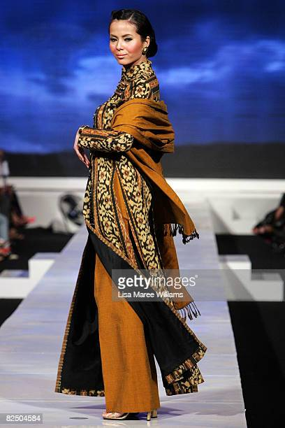 A model showcases Ethnic designs by Poppy Dharsono from the APPMI on the catwalk on the first day of the inaugural Festival Mode Indonesia Jakarta...