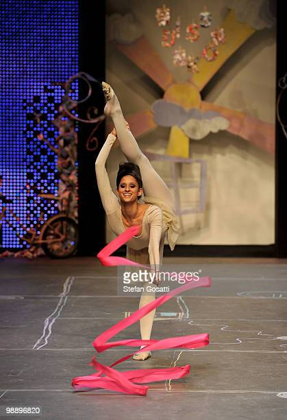 A model showcases her ribbon twirling skills on the catwalk during the Ms Unkon collection show on the fifth and final day of Rosemount Australian...