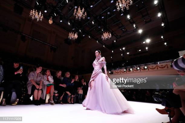 A model showcases J'Aton Couture designs during the Opening Town Hall Runway at Melbourne Fashion Week at Melbourne Town Hall on August 30 2019 in...
