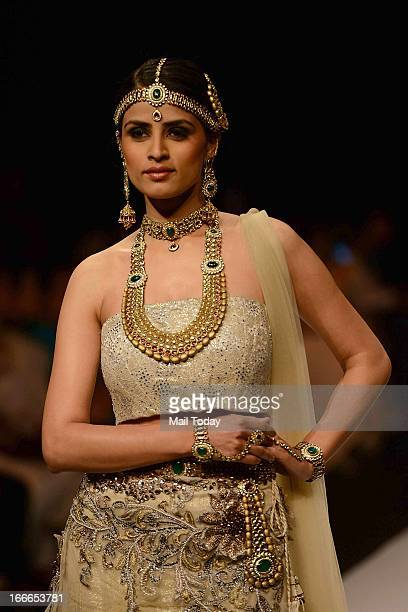 A model showcases jewellery by International Gemological Instiute at India International Jewellery Week on Friday