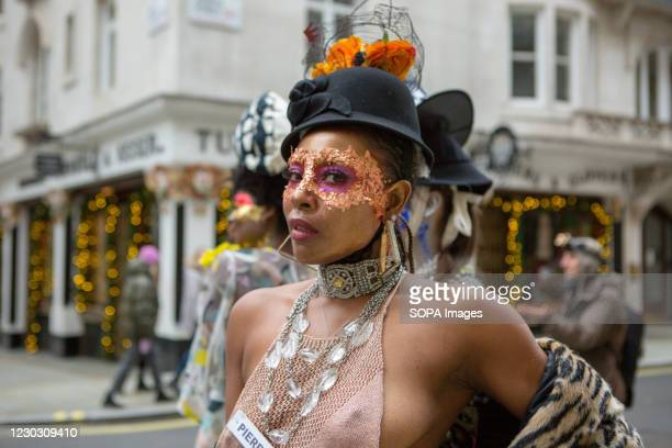 Model showcases Pierre Garroudi's latest collection on Boxing day at one of the designer's specialty flash mob fashion show in central London.