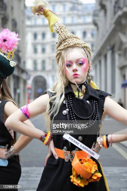 Model showcases Pierre Garroudis latest colorful collection at one of the designers specialty flash mob fashion shows in Oxford Circus, London.