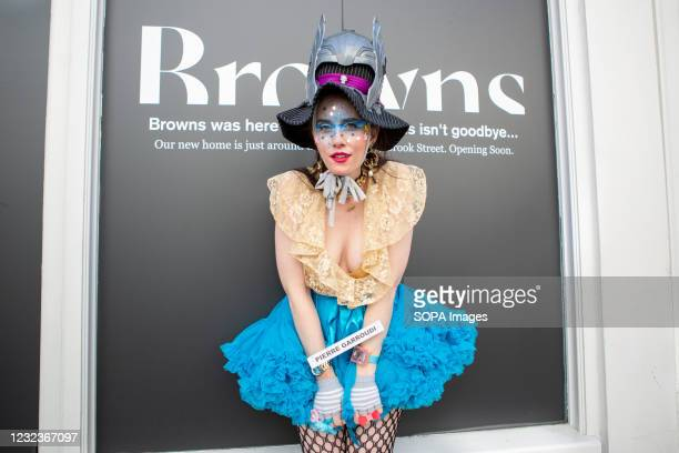 Model showcases Pierre Garroudi's latest colorful collection at one of the designer's specialty flash mob fashion show in Bond Street, London.