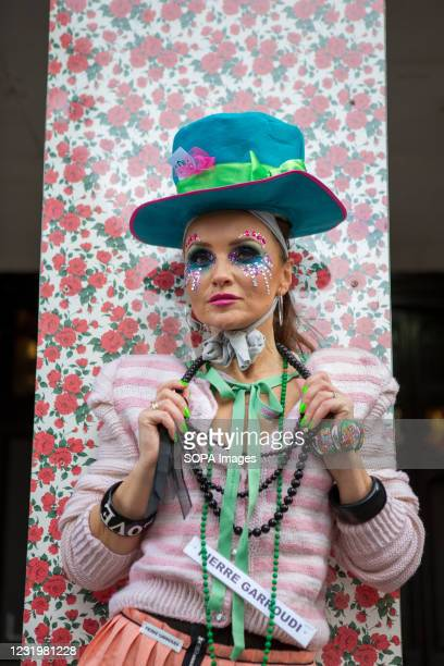 Model showcases Pierre Garroudi's latest colourful collection at one of the designer's specialty flash mob fashion shows in Central London.