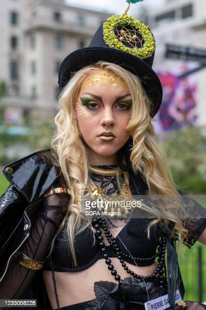 Model showcases Pierre Garroudi's latest colourful collection at one of the designer's specialty flash mob fashion show in central London.