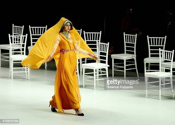 A model showcases Shafira designs by Fenny Mustafa on the runway at The La Dolce Vita show during Indonesia Fashion Week 2014 day 2 at Jakarta...