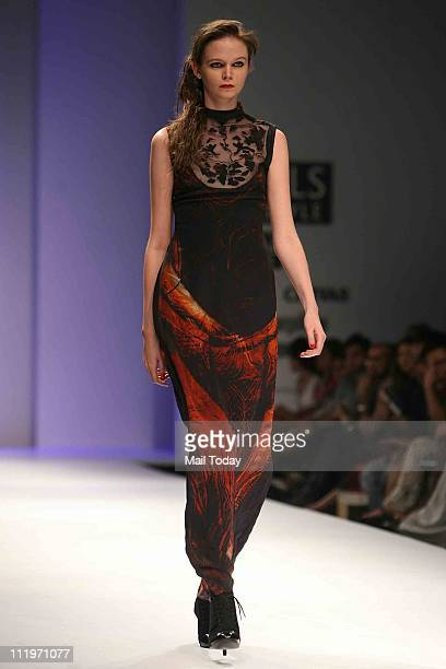 A model showcases the collection 'Walnut' by designers Nidhi and Divya Gambhir during the Wills Lifestyle India Fashion Week Fall/Winter 2011 in New...