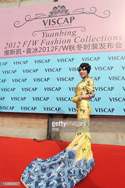 A model showcases the 'imperial robe' worn by Chinese actress Fan Bingbing during the 63rd session of Cannes Film Festival ahead of the Viscap Yuan...