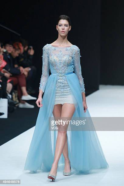 Model showcases wedding dress on the runway at AOLISHA Wei Xinkun Bridal Collection during the Mercedes-Benz China Fashion Week Spring/Summer 2016 at...