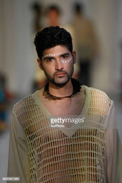 """Model showcasing clothes of designer """"John Ablaza"""" during the African Fashion Week in Toronto, Canada on 18 August 2017."""
