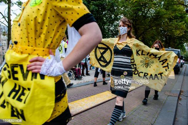 Model showing her dress with a climate message during the fashion show. An 'XR fashion show' was carried out in front of the House of Representatives...