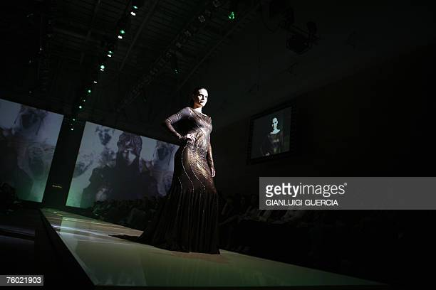 A model shows 08 August 2007 one of the creation of South African designer David Tlale during the Cape town fashion week in Cape Town AFP...