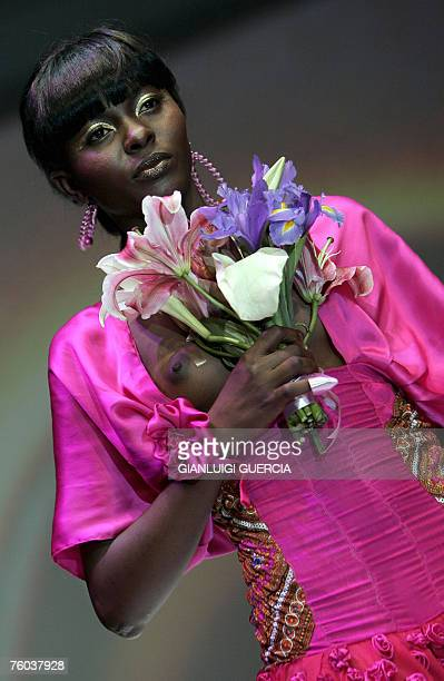 A model shows 09 August 2007 one of the creation of South African designer Mosa Makuena during the second day of the Cape Town fashion week in Cape...