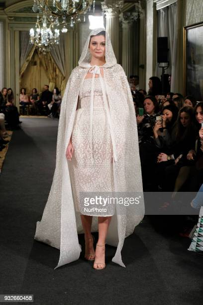 A Model shows a ALICIA RUEDA design during fashion week ATELIER COUTURE fashionable bridal and luxury in ceremony at the Fernan Nunez Palace in...