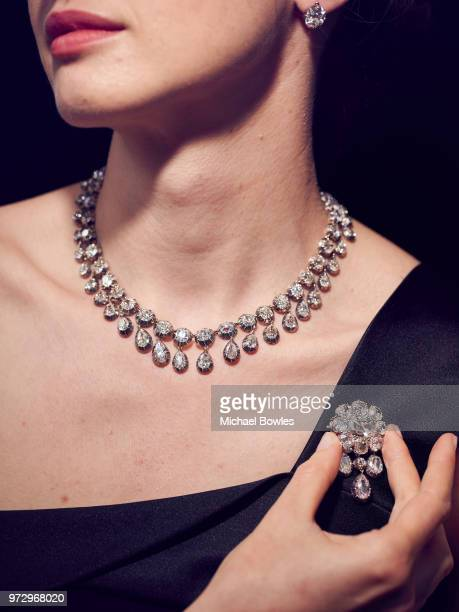 A model shows a diamond parure composed of 95 diamonds including five solitaire diamonds that belonged to MarieAntoinette Queen of France which was...