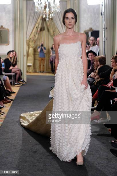 A Model shows a Laura Lomas design during fashion week ATELIER COUTURE fashionable bridal and luxury in ceremony at the Fernan Nunez Palace in Madrid...