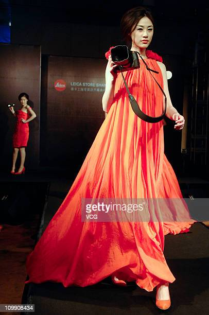 A model shows a Leica camera during the unveiling ceremony of a Leica Store on March 9 2011 in Shanghai China German camera company Leica opened the...