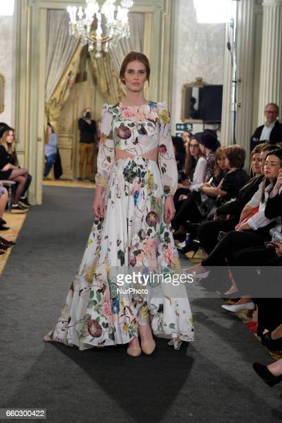 A Model shows a Raquel Ferreiro design during fashion week ATELIER COUTURE fashionable bridal and luxury celevbra ceremony at the Fernan Nunez Palace...