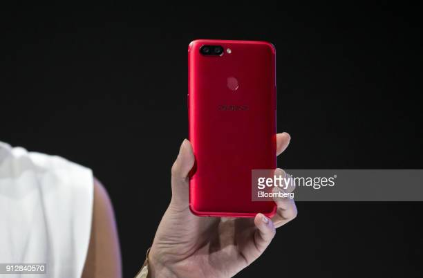 A model shows an Oppo R11s smartphone during a launch event of the smartphone for the Japanese market in Tokyo Japan on Wednesday Jan 31 2018 Oppo...