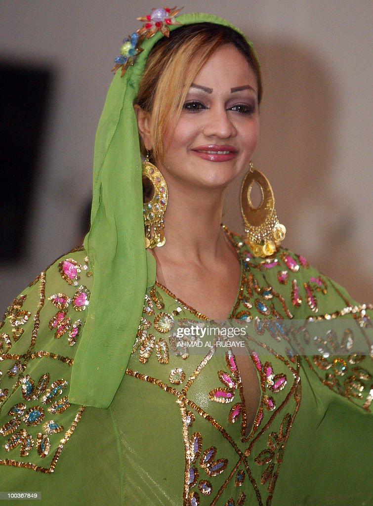 A model shows of a long organza dress with a matching head dress during a fashion show at the Ministry of Culture on May 24, 2010 in Baghdad.
