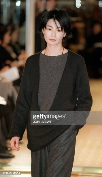 A model shows off 09 March a deep Vneck pullover in black cashmere over a dusky brown tunic with wide pants in charcoal shetlands during the...