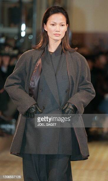 A model shows off 09 March a short transformable coat in charcoal camel over a cashmere doublebreasted semistructured jacket during the presentation...