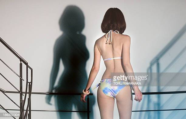A model shows off a bikini during the 2013 swimwear collection of Japan's fashion company Sanai in Tokyo on November 13 2012 AFP PHOTO/Toru YAMANAKA