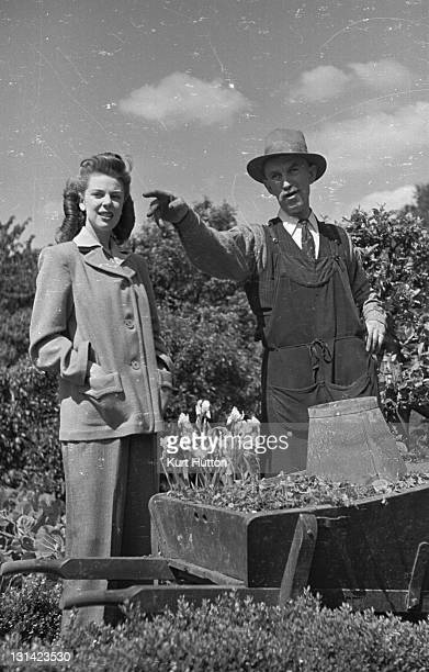 A model shows off a box jacket with slacks a green crepe blouse from Fenwicks 19th June 1943 Original Publication Picture Post 1464 Fashions For...