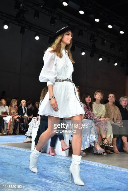 A model shows off a creation by Australian designer We Are Kindred during Fashion Week Australia in Sydney on May 14 2019