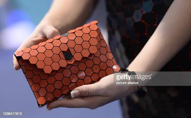 A model shows off a handbag that was made with a 3D printer by 'Airwolf 3D' at CES in Las Vegas Nevada USA 07 January 2015 The trade fair takes place...