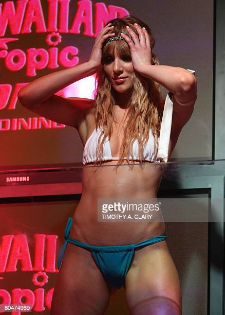 A model shows off a swimsuit of designer Nancy E during a fashion show to introduce her Sassi 08 Collection at the Hawaiian Tropic Zone in New York...