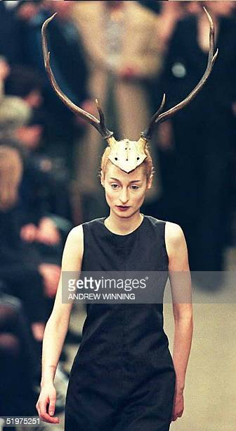 A model shows off headgear fashioned from antlers during Alexandre McQueen's Autumn/Winter show 01 March on the third day of London Fashion Week