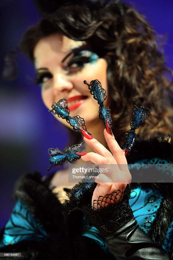 A model shows off her nails, which was the work of a participant in the 'Haut Couture' contest of the OMC Hairworld World Cup on May 4, 2014 in Frankfurt am Main, Germany.