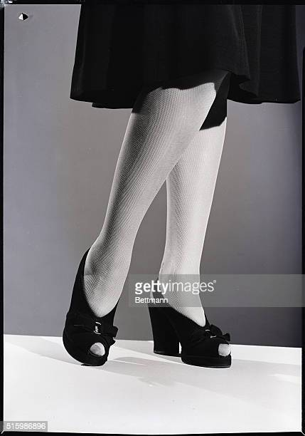 A model shows off the look of rayon mesh stockings Undated photograph