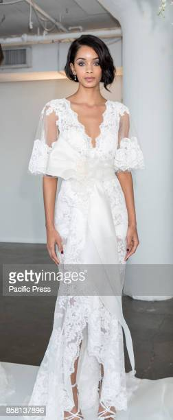A model shows out a dress by Georgina Chapman and Keren Craig for Marchesa and Notte Fall/Winter 2018 Bridal Presentation during New York...